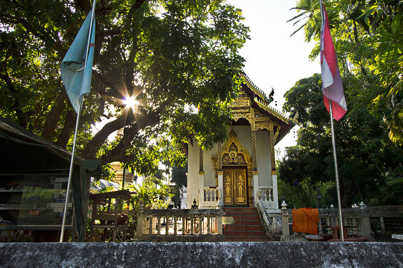 Sun sets over small prayer hall at lesser-known Wat Nantaram in Chiang Mai, Thailand