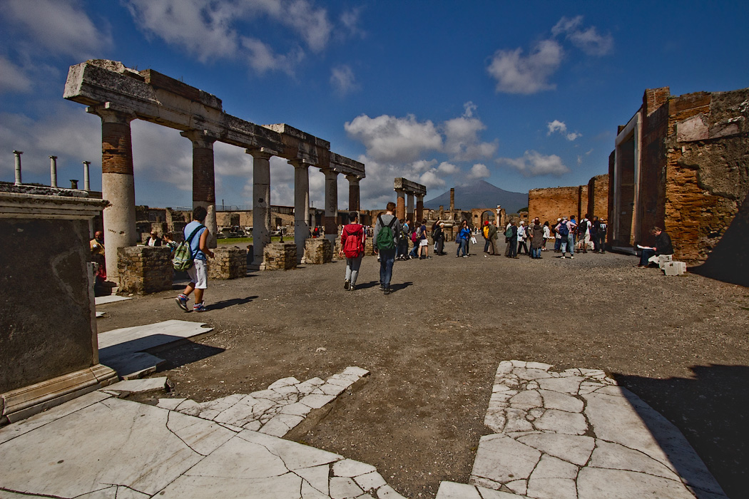 The Forum of Pompeii, a large market area surrounded by the most important buildings in the town. Shown in the foreground are remains of the travertine paving that once covered the entire square.