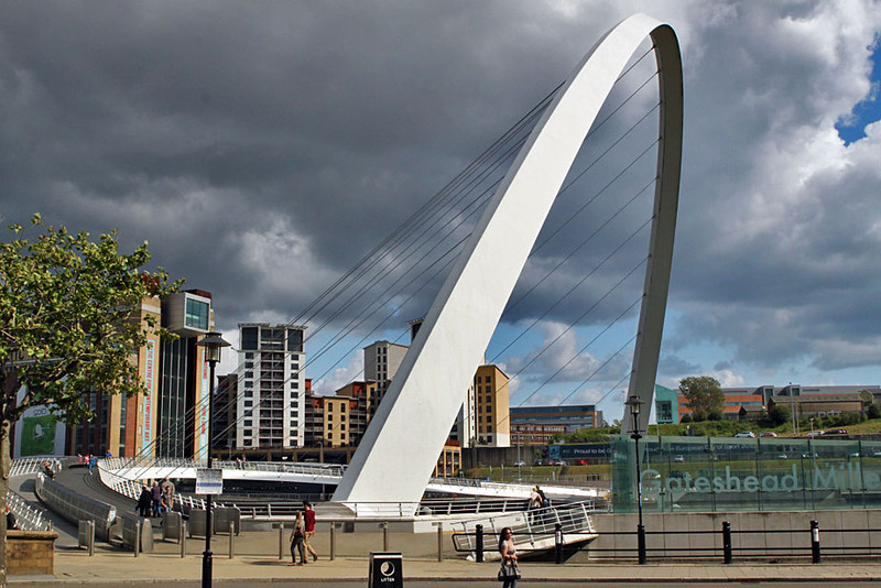 Gateshead Millennium Bridge in Newcastle, England tilts up for river traffic