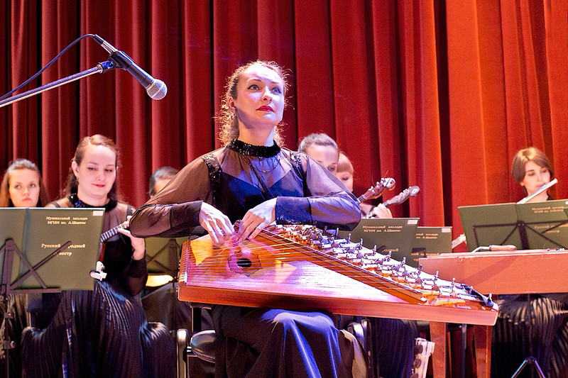 Musician plays a solo on her Gusli, a traditional Russian folkloric instrument, during a performance by the Moscow Folk Orchestra