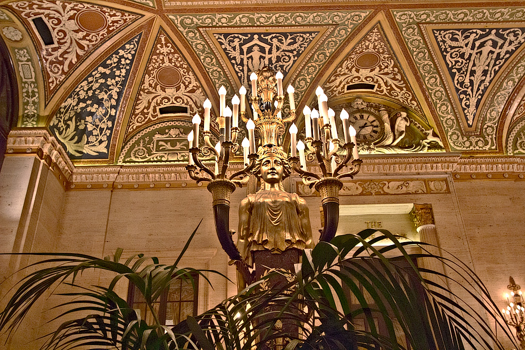 One of a pair of Italian Renaissance gilt-bronze torchieres in the lobby of Chicago's historic Palmer House Hotel