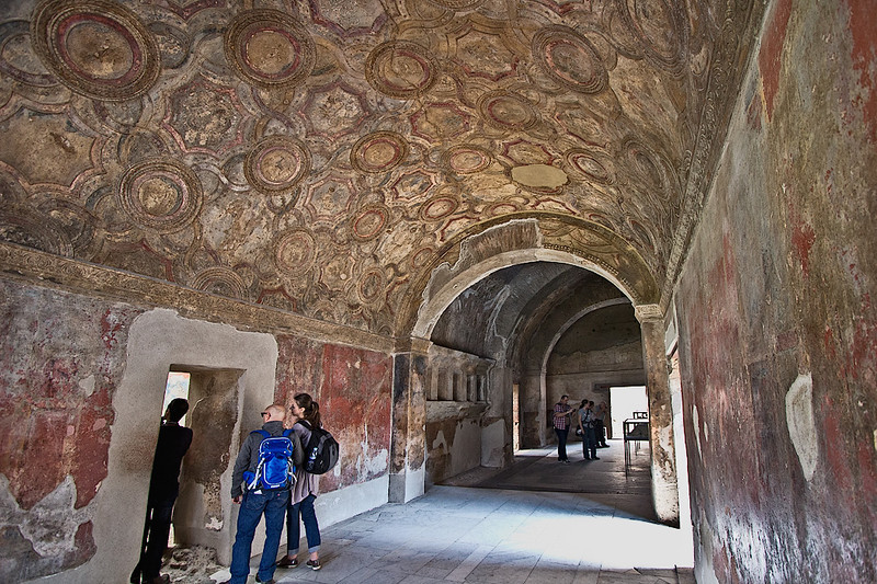 Intricate frescoes on the barrel vaulted plaster ceiling of the Stabian Baths in Pompeii. Public bath houses were an important part of the social structure in the ancient Roman city.