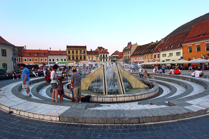 Fountain in the center of  Piata Sfatului, in the Old Town of Brasov, Romania