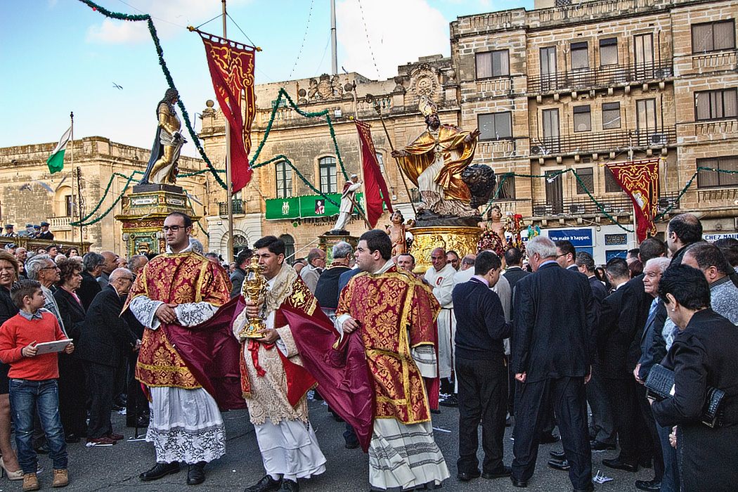 Priests lead procession during the Feast of St. Publius, the patron saint of the city of Floriana, on the island of Malta