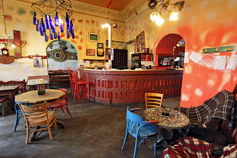 Crazy colors and mismatched furniture at Insomnia Cafe in Cluj-Napoca, Romania
