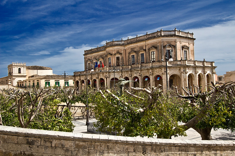 Municipio (Town Hall) in the Baroque town of Noto, one of three towns that were entirely rebuilt on new sites after the earthquake of 1693. Buildings were constructed of a local limestone that glows a soft honeyed gold color at sunset.