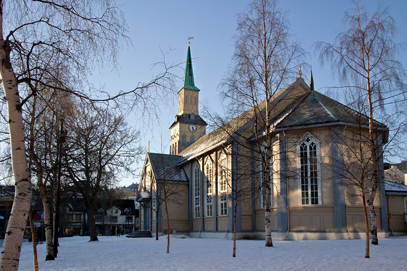 Old Wooden Cathedral in the center of Tromso, Norway, on a sunny but cold afternoon