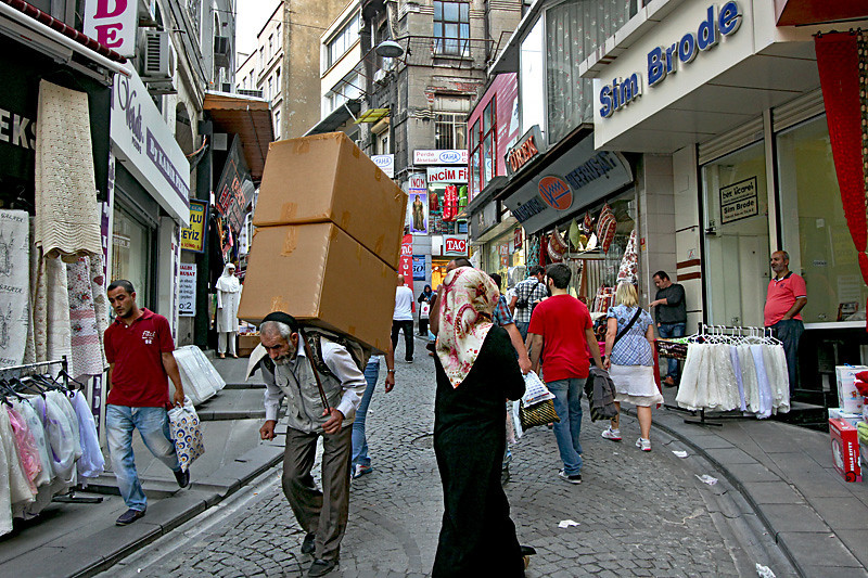 Carrying cargo through the cobblestone streets of Istanbul, Turkey