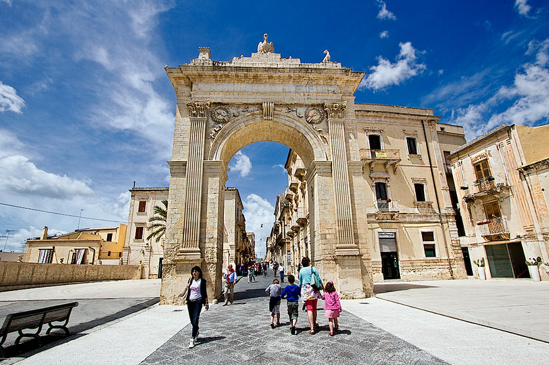 Porta Reale (Royal Gate) stands at the head of Corso Vittorio Emanuele, the main thoroughfare in the Baroque town of Noto, Sicily. It is also known as Porta Ferdinandea, as it was constructed in 1838 to commemorate a visit by King Ferdinand II of Bourbon.