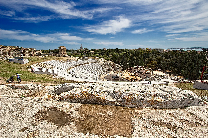 The Greek Amphitheater in Syracuse, Sicily, built in the fifth century BC, was the the largest in the Western Mediterranean. It was used to space was used for theater and public meetings. It is still each spring as a venue for a festival of classical Greek plays.