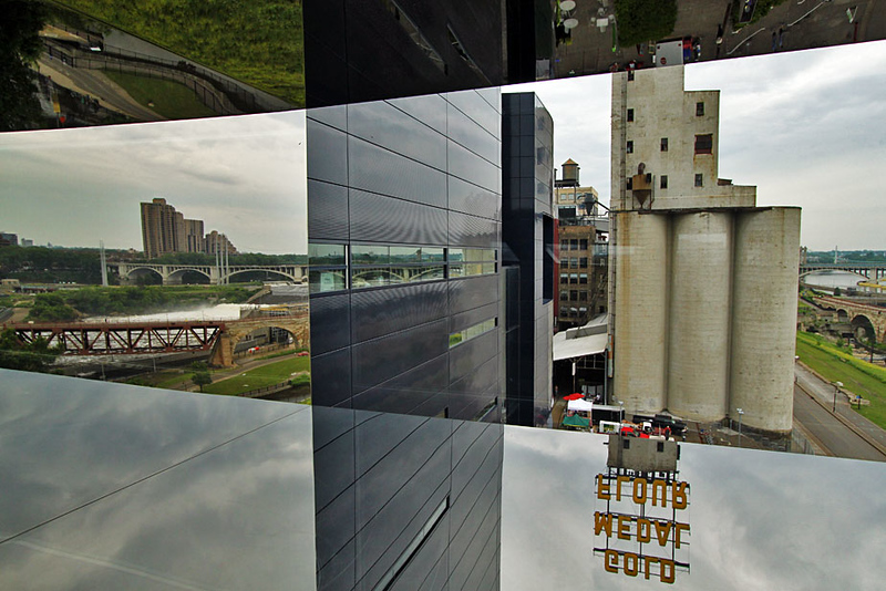 Mississippi Riverfront from Endless Bridge at the Guthrie Theater in Minneapolis, Minnesota. The old flour silos are real, everything else is a reflection in the mirrored edges of the window.