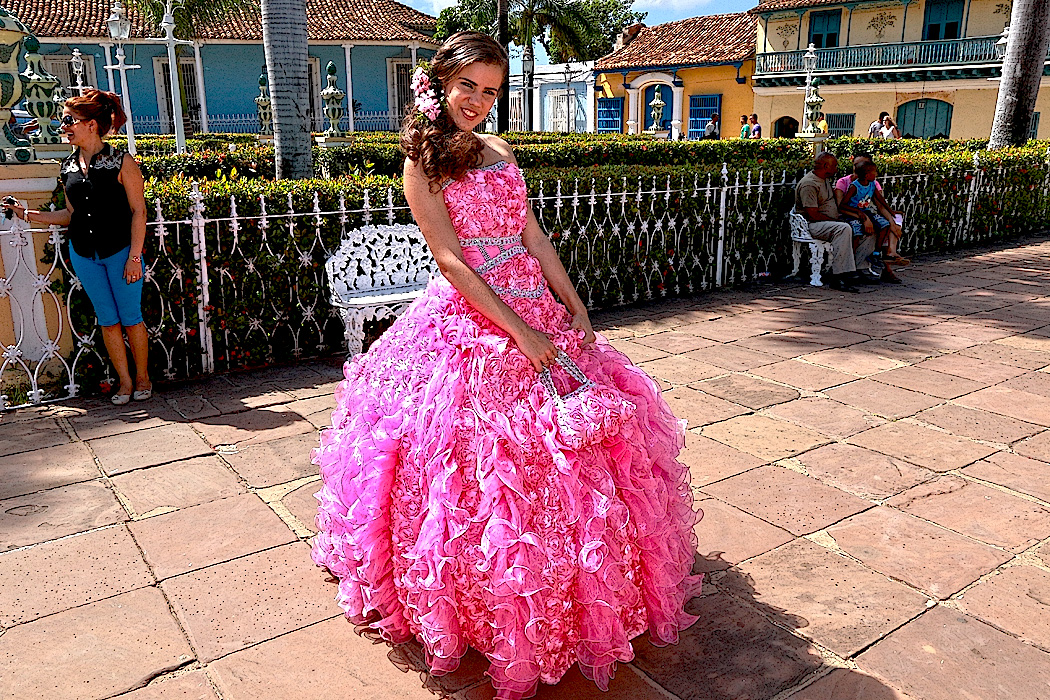 Girl poses for photos to celebrate her Quinceanera (15th birthday), in the Central square of Trinidad, Cuba
