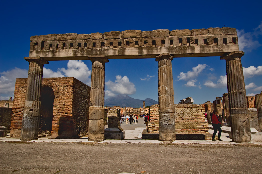 Capped columns mark one end of the Forum at the Roman ruins in Pompeii, Italy, which was destroyed by the eruption of Mount Vesuvius in 79 AD