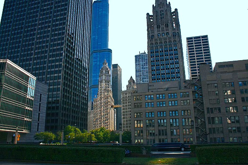 Skyscrapers along Chicago's Magnificent Mile include the Wrigley Building (at center with clock tower), which was built to house the corporate headquarters of the Wrigley Company