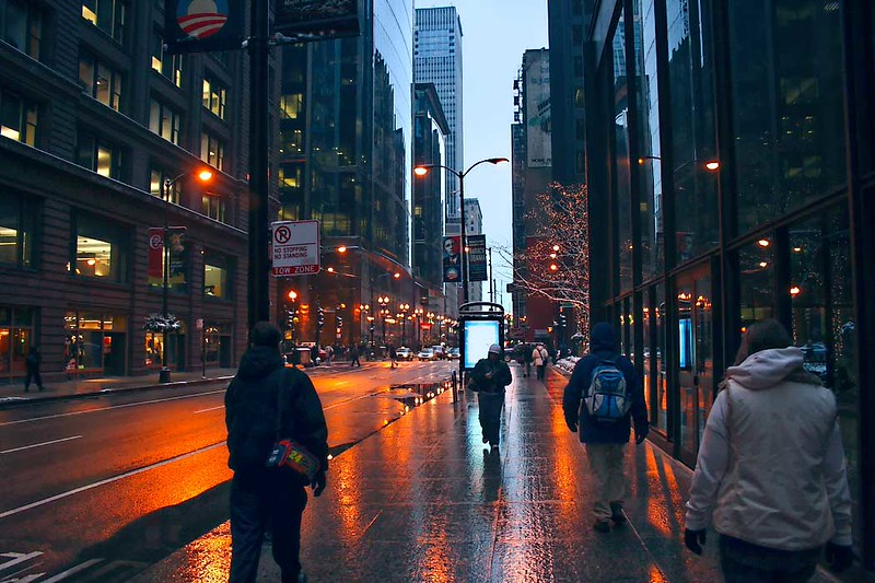 A cold winter rain slicks streets and sidewalks in downtown Chicago