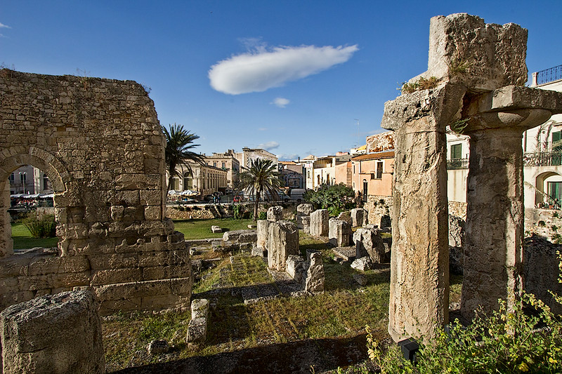 The Temple of Apollo, dating from the 6th century B.C., stands at the entrance to Ortigia Island, home to the Old Town in Syracuse, Sicily. It is the oldest known Doric temple of the Greeks who inhabited ancient Rome.