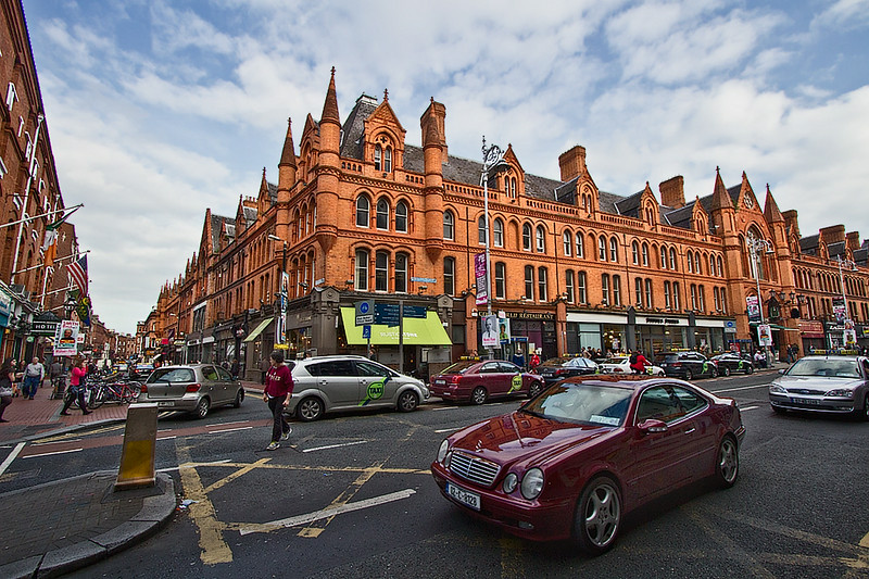 Massive red brick, turreted buildings on South Great George's Street in Dublin, Ireland
