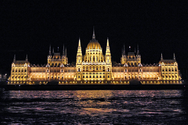 Gothic and Renaissance Revival style Parliament Building seems to float on the Danube River in Budapest, Hungary