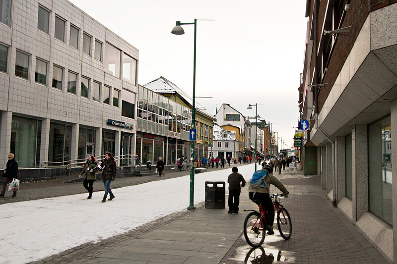 Storgata Street, the main pedestrian mall in Tromso, Norway, is full of people despite the weather