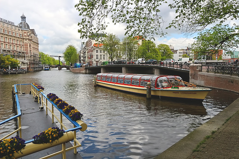 Boats on the Binnen Amstel Inner Amstel River in Amsterdam, Netherlands