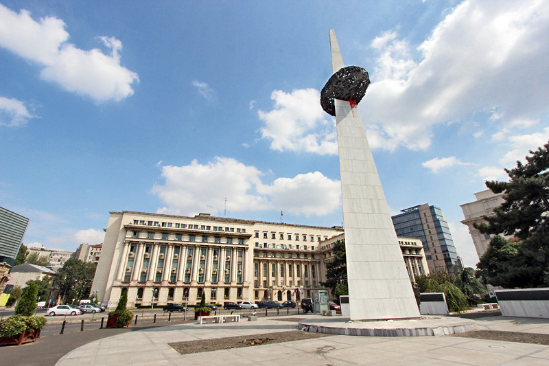 Memorial of Rebirth sculpture stands in front of former communist headquarters in Bucharest, Romania