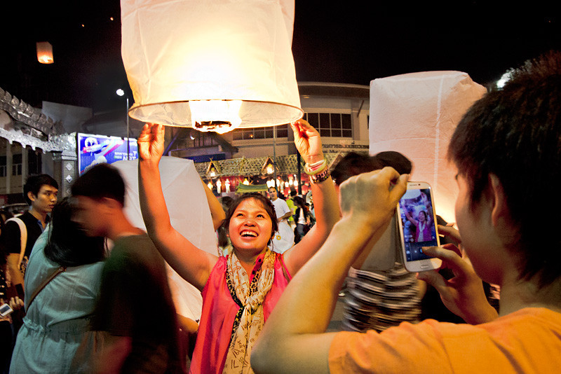 Paper lanterns are launched into sky for good luck at Yee Peng celebration in Chiang Mai, Thailand