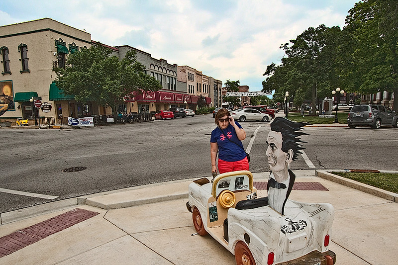 Mini cars are scattered around he sidewalks of Pontiac, Illinois, which is not only on U.S. Route 66, but can claim that President Lincoln spent time in the city