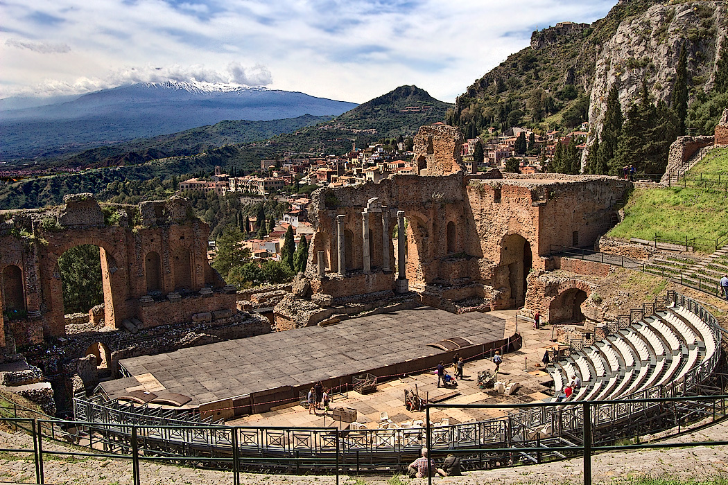 The Greek Amphitheater in Taormina, Sicily, with snow-capped Mt. Etna in the distance