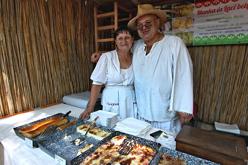 Couple proudly display mouthwatering Hungarian pastries at the Sunday Market in the Kali Basin