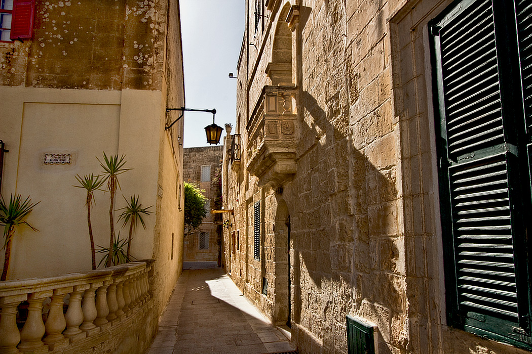 Typical walkway between the ancient stone buildings in Mdina, the original capital of Malta