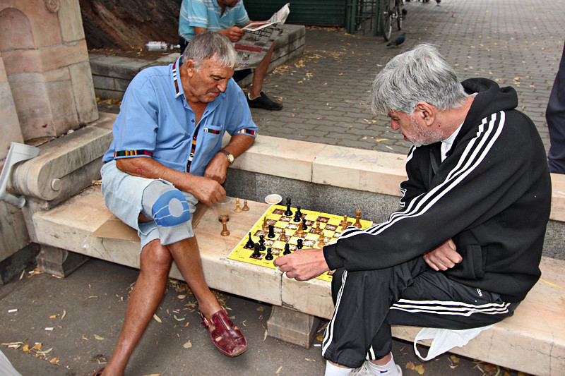 Men relax with a game of chess in Ivan Vasov Garden in Sofia, Bulgaria