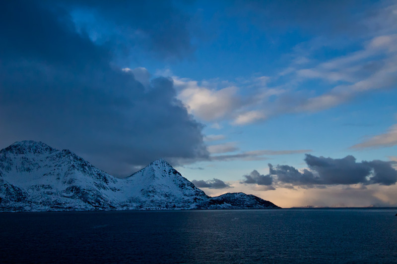 Blue on blue scenery at sunset during sail between Oksfjord and Skjervoy, Norway