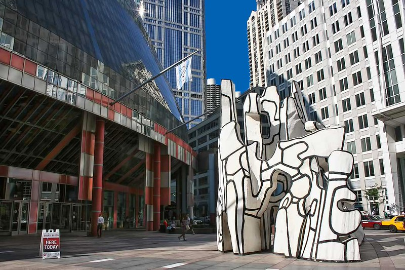 "The James R. Thompson Center in downtown Chicago houses offices of the Illinois state government. The sculpture in front of it is titled ""Monument With Standing Beast."""