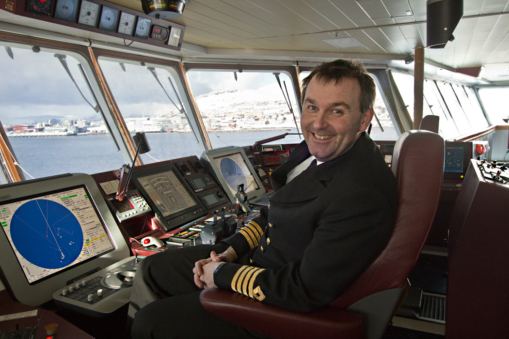 Captain Tommy Eliassen on the bridge of the Hurtigruten's MS Richard With