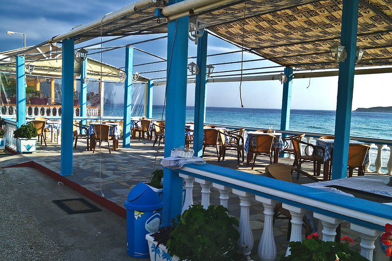Open-air beachfront restaurant in Arillas, on the island of Corfu, Greece