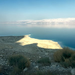 Sunset over the Dead Sea. Swimming in areas other than designated beaches is very dangerous, as the shoreline is littered with sinkholes that can open up unexpectedly and swallow everything.