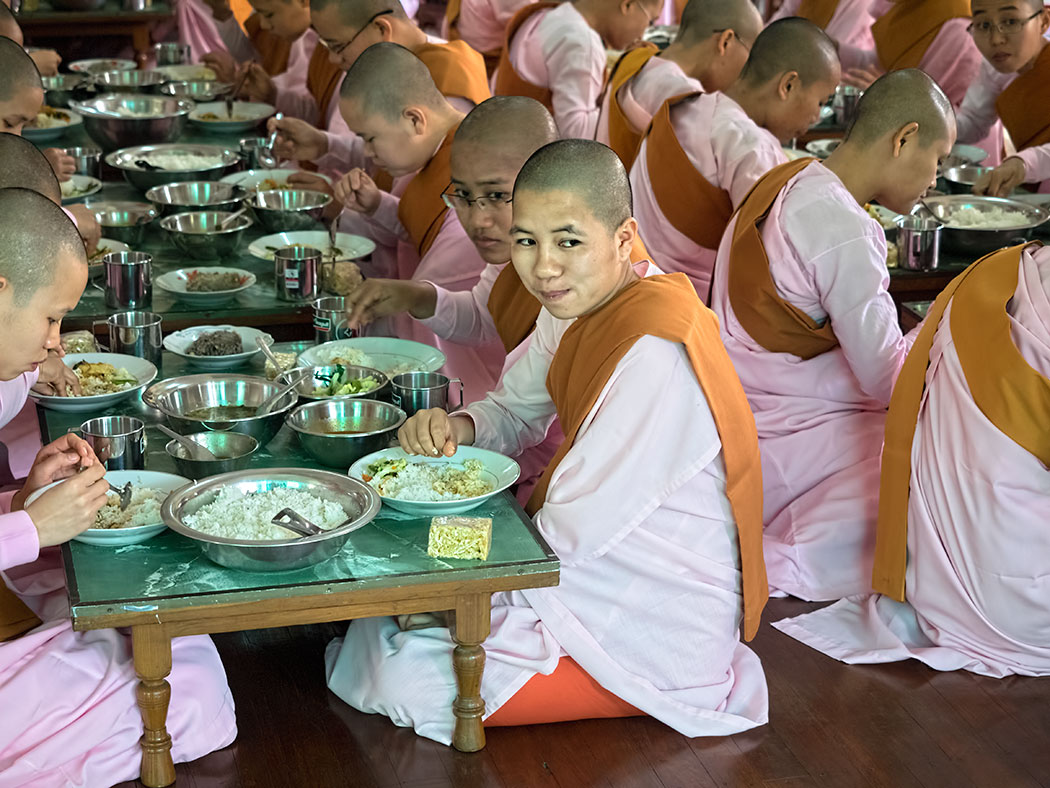 Nuns share a mid-morning meal at a nunnery on Sagaing Hill, near Mandalay, Myanmar