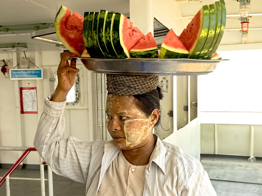 All manner of goods carried on the head are sold to passengers of the ferry that continually crosses between Yangon and the small village of Dala in Myanmar