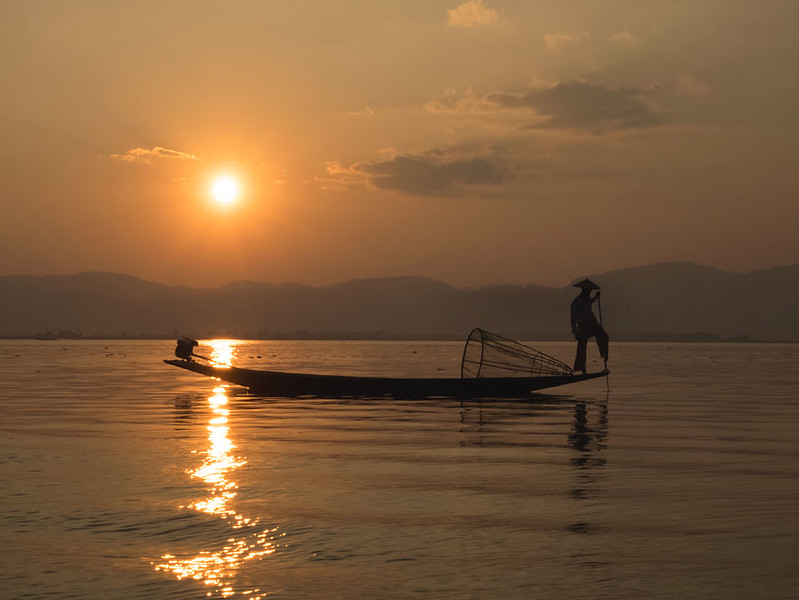 Traditional fisherman with cone net on Inle Lake, Myanmar