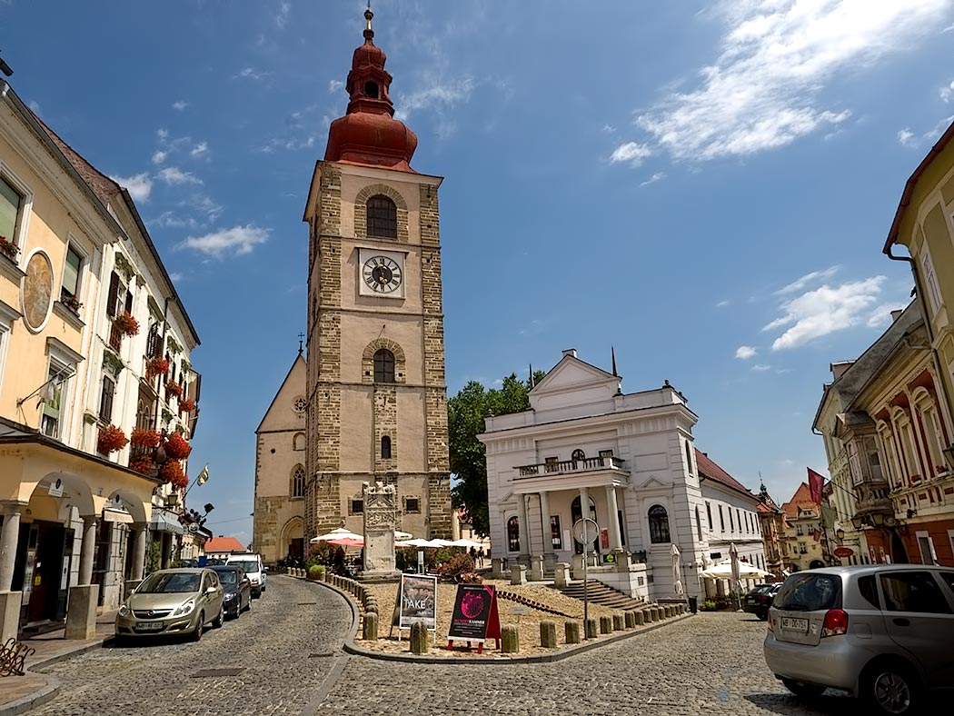 The Town Tower and Ptuj Town Theater in Ptuj, Slovenia. The Orpheus Monument, a carved marble Roman tombstone that stands in front of the tower, is probably from the second century and is considered the symbol of the town