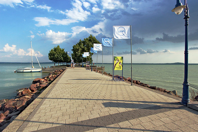 Revfulop Pier stretches out into the eye-popping multi-colored waters of Lake Balaton, Hungary
