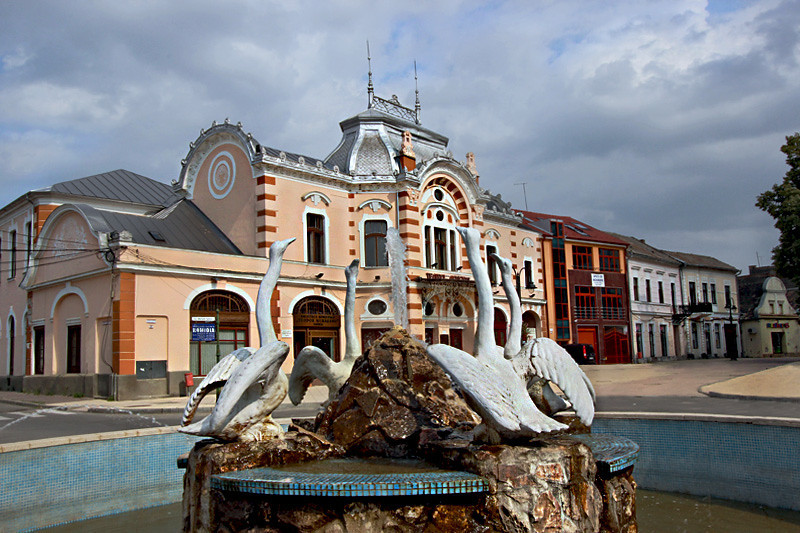 Fountain and Municipal Theater, just one of numerous lovely old buildings in Turda, Romania