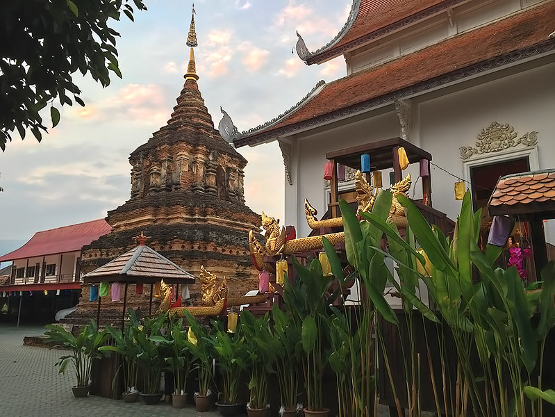 Brick Chedi constructed in the Mondop style and Viharn (worship hall) at Wat Jet Lin in Chiang Mai, Thailand, dates back to the 16th century