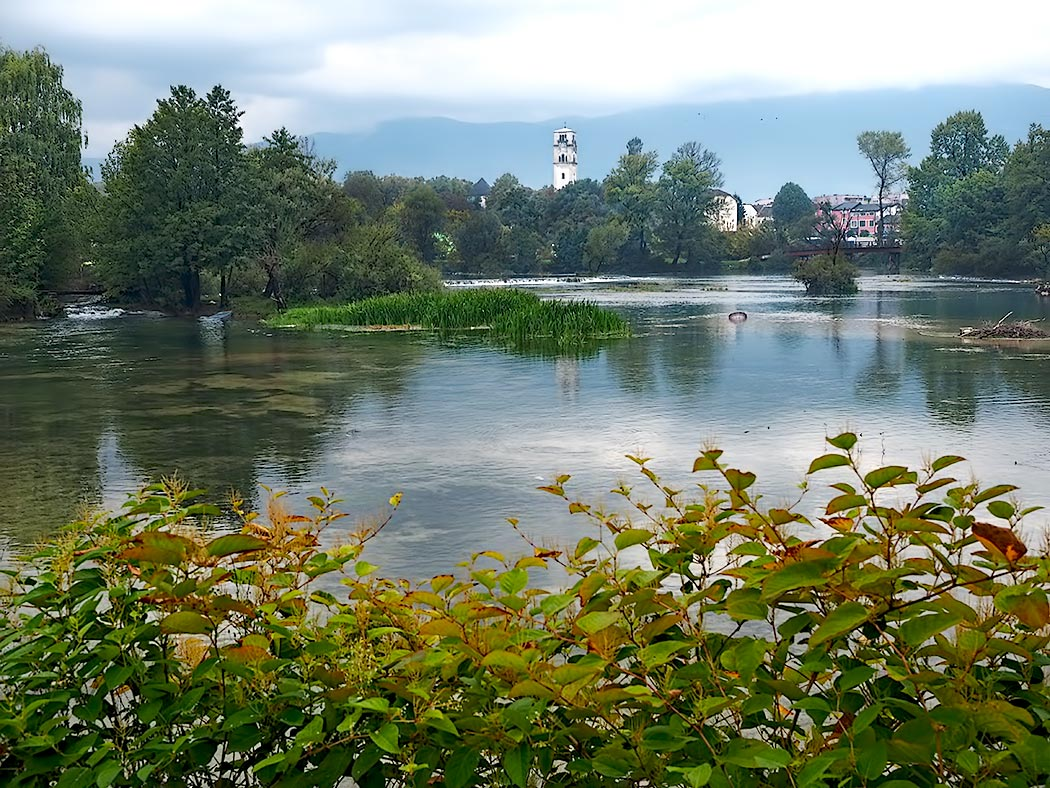 The Una River in Bihac, Bosnia-Herzegovina. Bihac is popular with tourists who are visiting Una National Park, located just a few kilometers from the city. The upper river has some spectacular waterfalls, and whitewater rafting trips are a popular activity in the park.