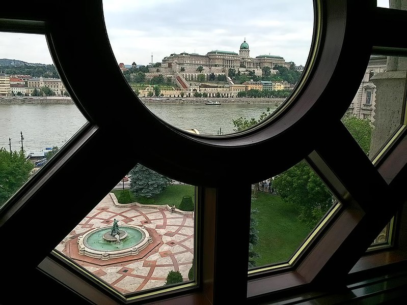 Budapest Castle on the Buda side of the city, seen through a window of the newly restored Vigado Palace on the Pest side